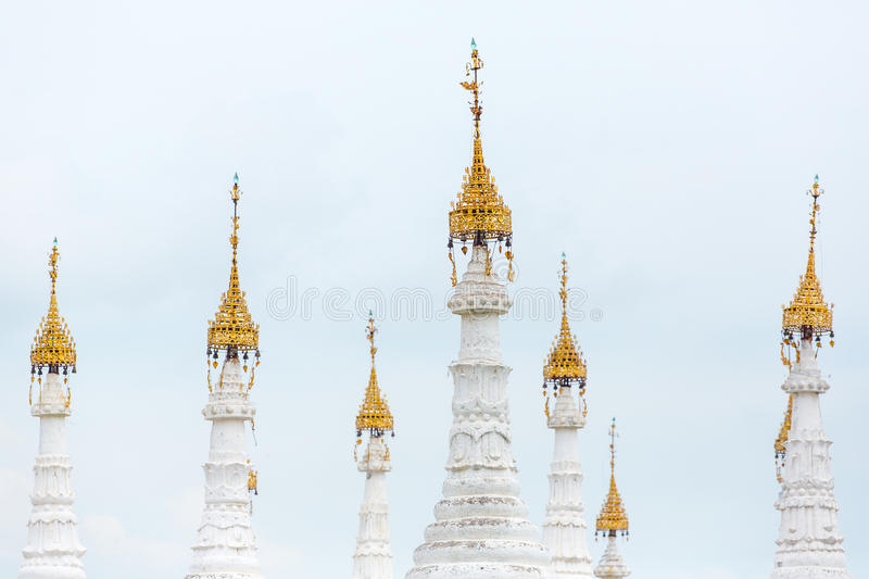 White stupas of Kuthodaw Pagoda with Tripitaka Stones Inscriptions inside in Mandalay. Myanmar stock image
