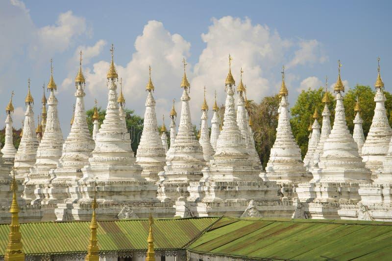 The white stupas of Sandamuni pagoda on a sunny day. Mandalay, Myanmar Burma stock image