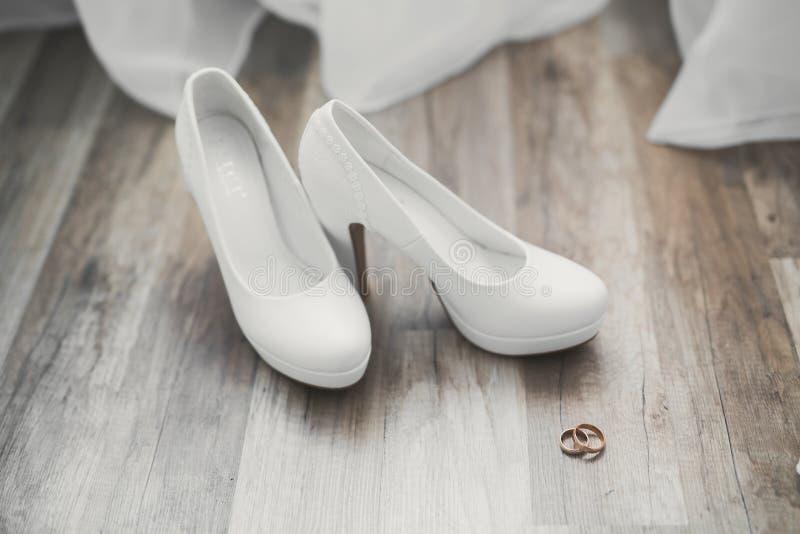 White stylish wedding shoes for bride. Close-up.  royalty free stock photography