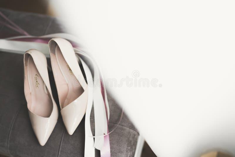 White stylish wedding shoes for bride. Close-up.  stock photo