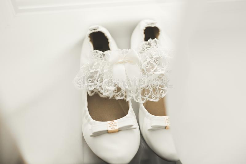 White stylish wedding shoes for bride. Close-up royalty free stock photo