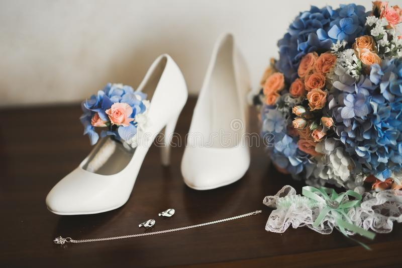 White stylish wedding shoes for bride. Close-up stock photo