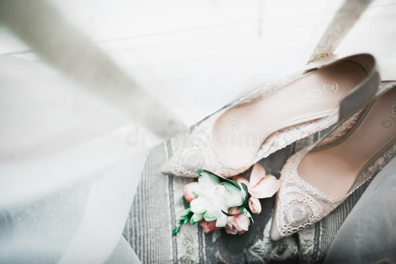 White stylish wedding shoes for bride. Close-up royalty free stock images