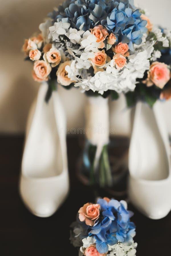 White stylish wedding shoes for bride. Close-up.  royalty free stock photos
