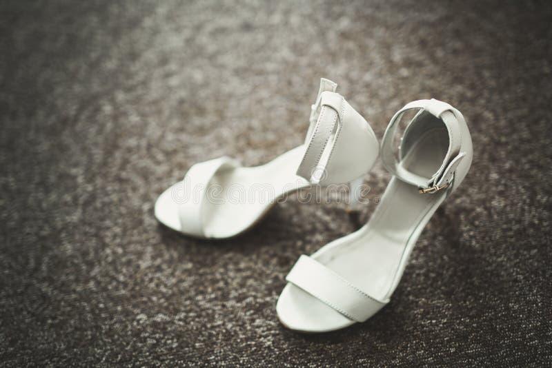 White stylish wedding shoes for bride. Close-up.  royalty free stock photo