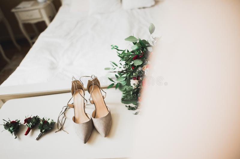White stylish wedding shoes for bride. Close-up.  royalty free stock photos