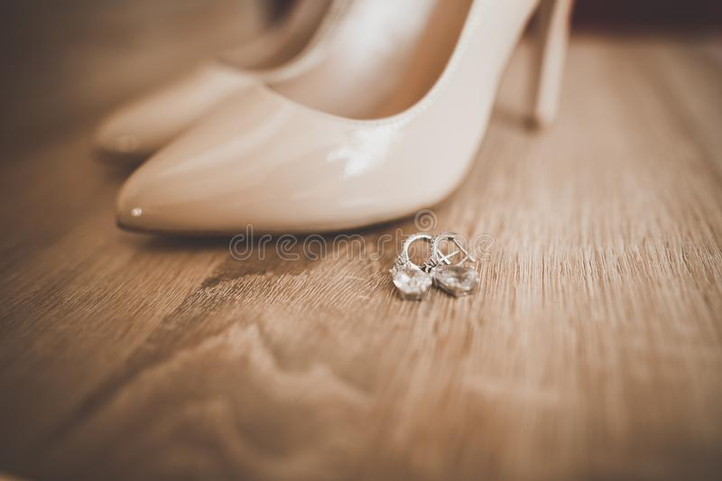 White stylish wedding shoes for bride. Close-up royalty free stock photos