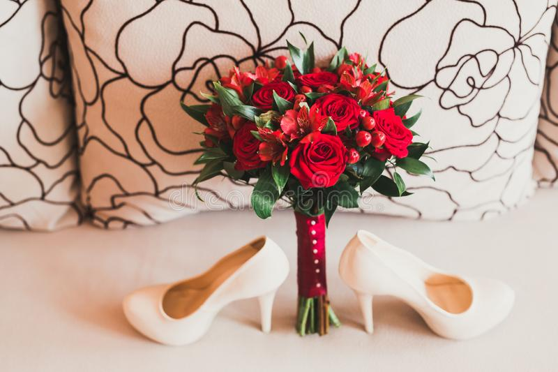 White stylish wedding shoes for bride. Close-up stock images