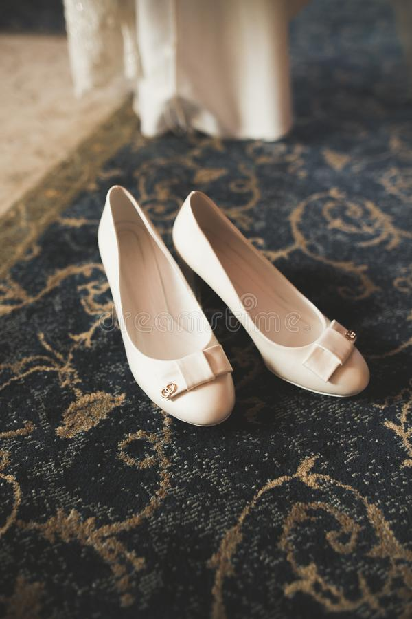 White stylish wedding shoes for bride. Close-up.  royalty free stock images
