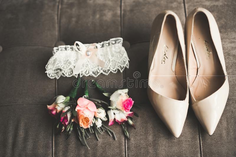 White stylish wedding shoes for bride. Close-up stock image