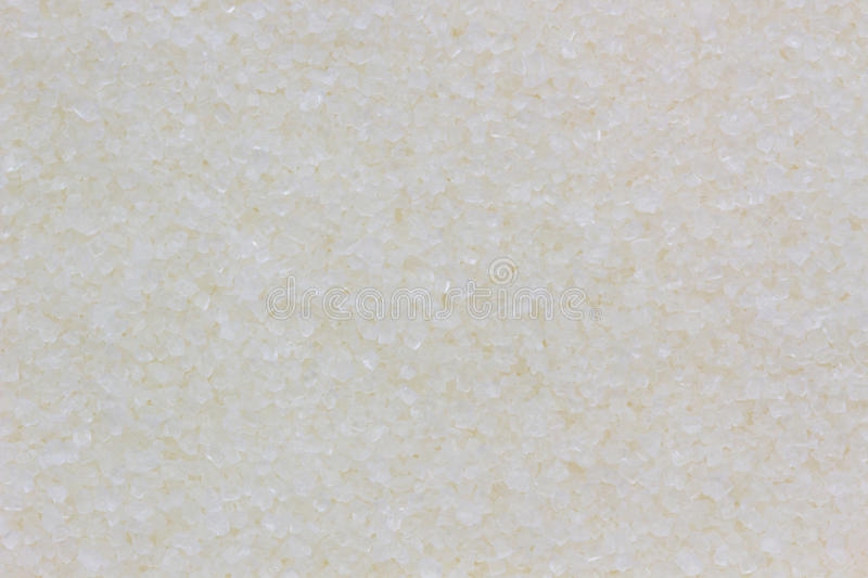 White sugar as an abstract background or texture stock images