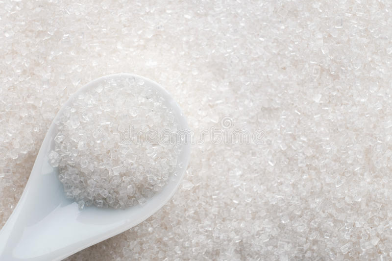 White sugar in ceramic spoon royalty free stock images
