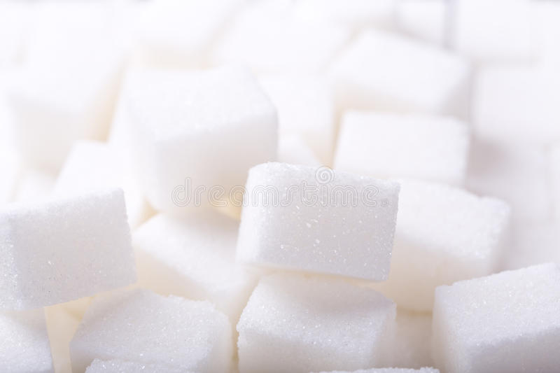 White sugar cubes. Close up of white sugar cubes as background royalty free stock image