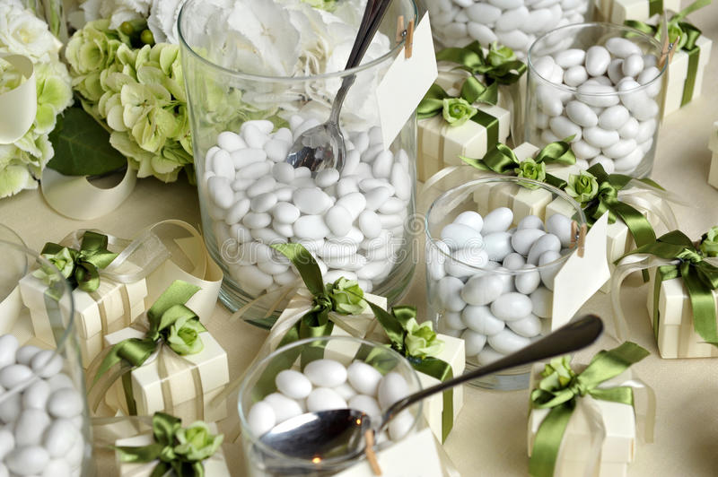 White Sugared Almonds On Glasses And Gift Boxes Stock Photo