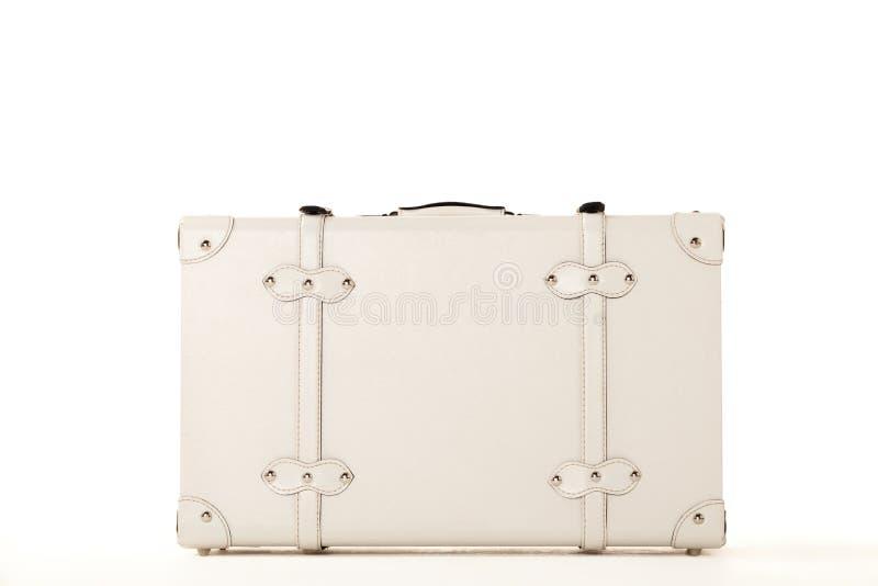 White suitcase on white bacground. White suitcase on white background, standing on white surface royalty free stock image
