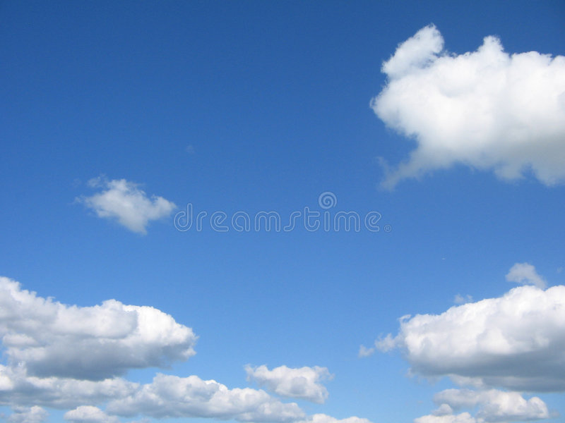 White summer clouds. Beautiful white summer clouds on a gentle breeze royalty free stock images
