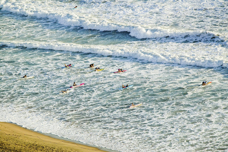 White surf and beach where surfer school sets out for surfing in Durban, South Africa on the Indian Ocean stock photography