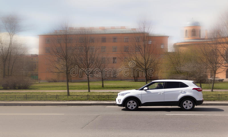 White SUV. On the city streets, a white jeep stock photography