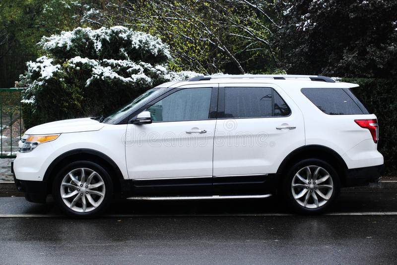 White Suv. A white suv with office building royalty free stock photography