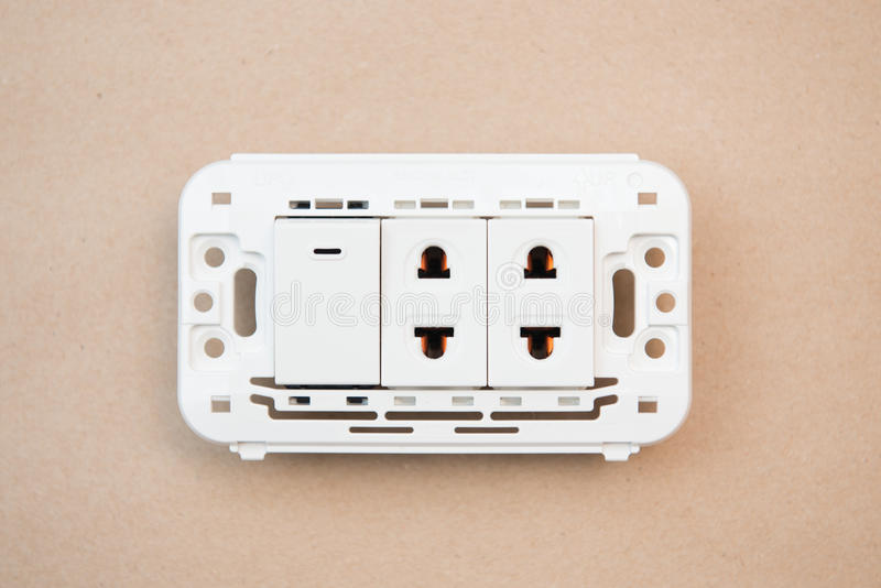 White switches and outlet. Electricity royalty free stock photos