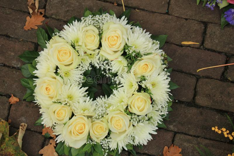 White sympathy wreath. Sympathy wreath made of various white flowers stock image
