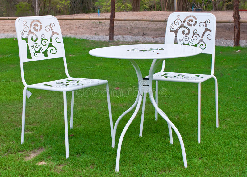 Download White Table And Chairs In Lawn Stock Image - Image: 25599271