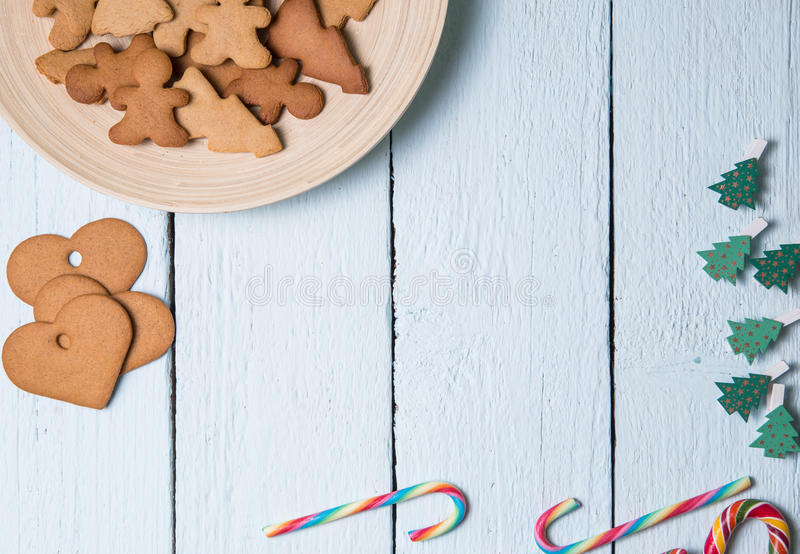 White table with Christmas cookies. White wooden table with Christmas cookies, caramel sticks stock photo