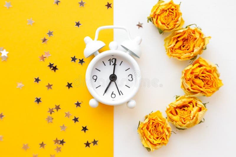 White table clock, alarm on yellow background, top view. Good morning. Minimalism, flatlay. White table clock, alarm on yellow background, top view. Good morning royalty free stock photos