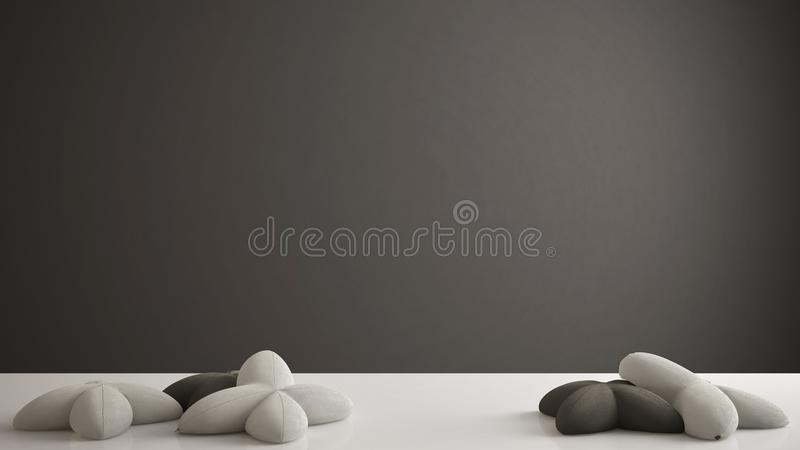 White table, desk or shelf with five soft gray and black pillows in the shape of stars, blank background with copy space, interior royalty free stock photos