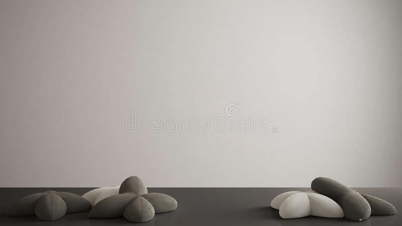 White table, desk or shelf with five soft gray and black pillows in the shape of stars, blank background with copy space, interior. Design concept stock illustration