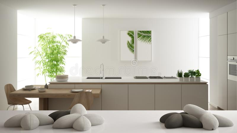 White table, desk or shelf with five soft white pillows in the shape of stars or flowers, over blurred modern white kitchen,. Minimalist architecture interior royalty free illustration