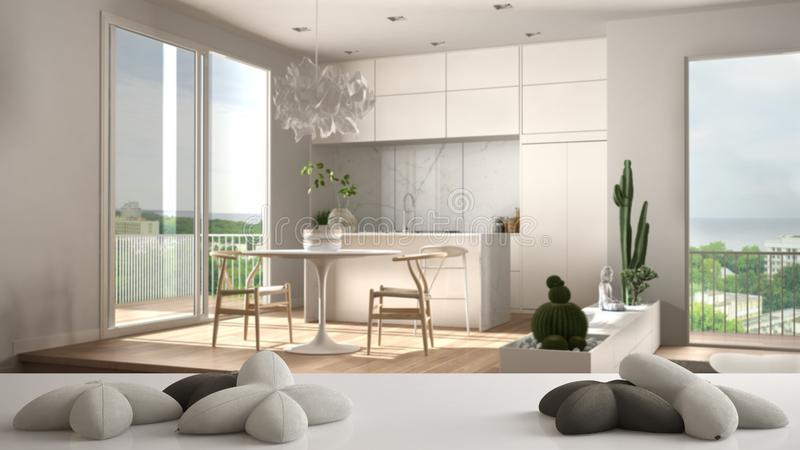 White table, desk or shelf with five soft white pillows in the shape of stars or flowers, over blurred modern living room, kitchen. White architecture interior stock illustration