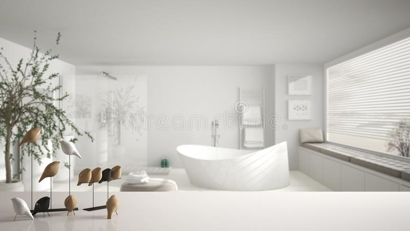 White table top or shelf with minimalistic bird ornament, birdie knick - knack over blurred contemporary bathroom with big panoram. Ic window, modern interior stock photos