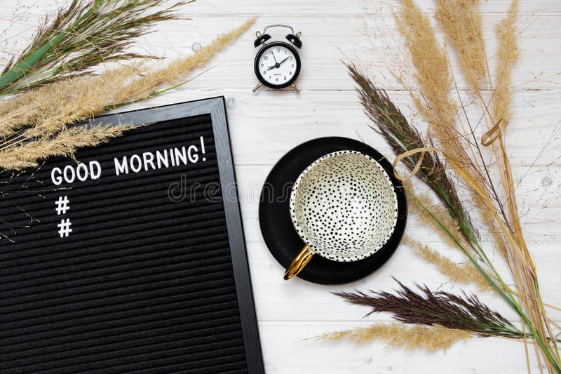 White tabletop  with good morning sign and empty cup royalty free stock photography