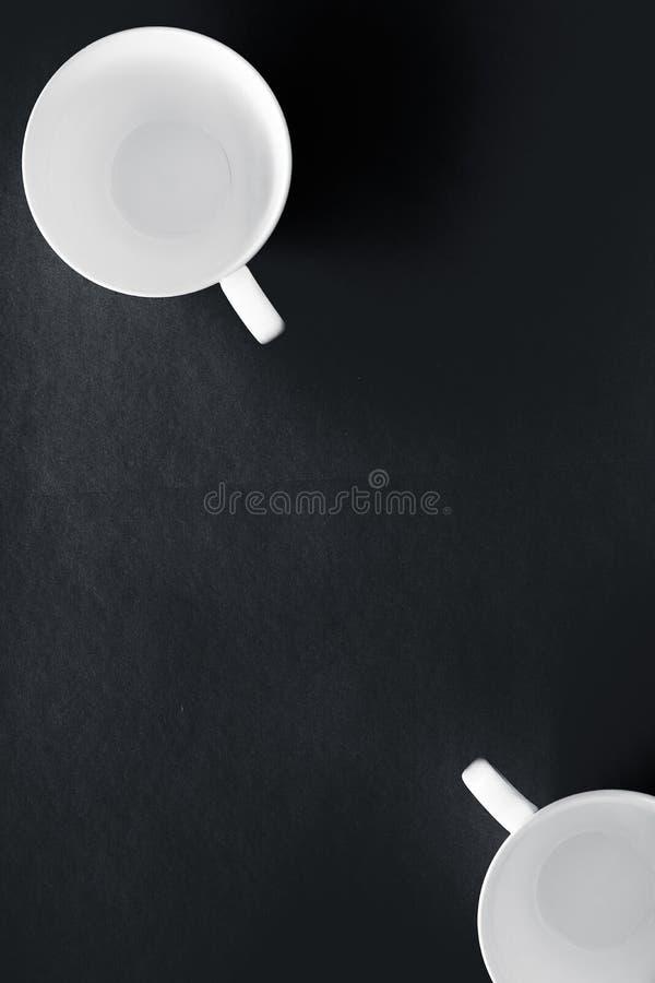 White tableware crockery set, empty cup on black flatlay background stock image
