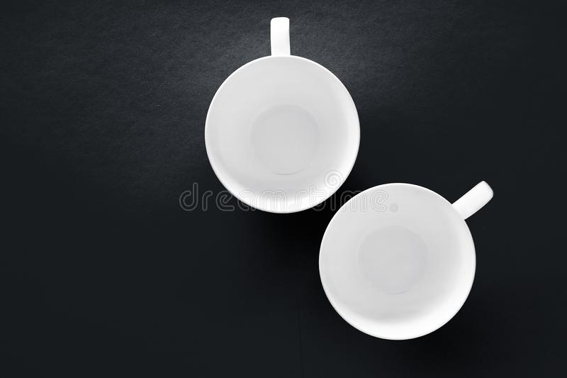 White tableware crockery set, empty cup on black flatlay background royalty free stock photography