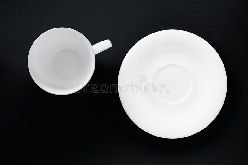 White tableware crockery set, empty cup on black flatlay background. Kitchen, table decor and drinks menu concept - White tableware crockery set, empty cup on stock images