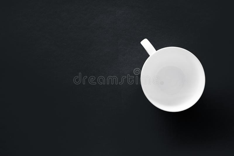 White tableware crockery set, empty cup on black flatlay background. Kitchen, table decor and drinks menu concept - White tableware crockery set, empty cup on stock photography