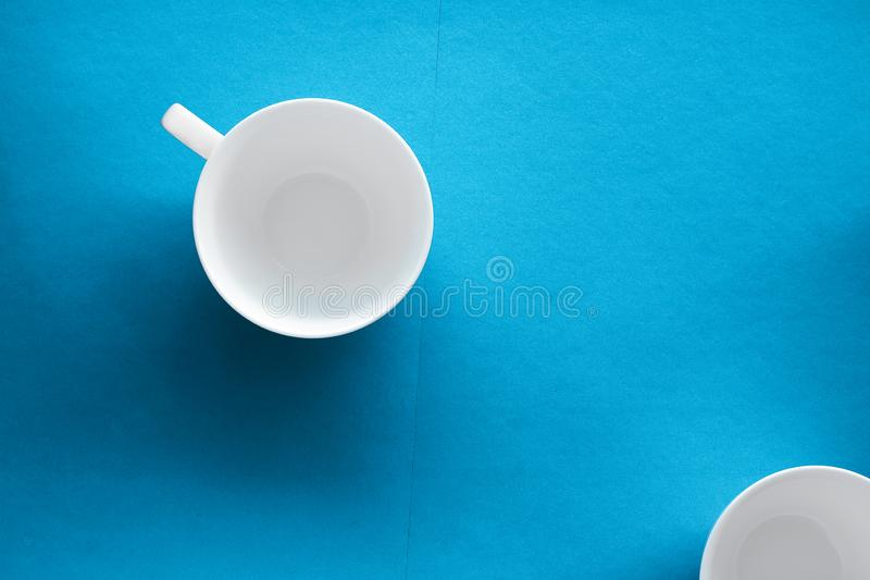 White tableware crockery set, empty cup on blue flatlay background stock image
