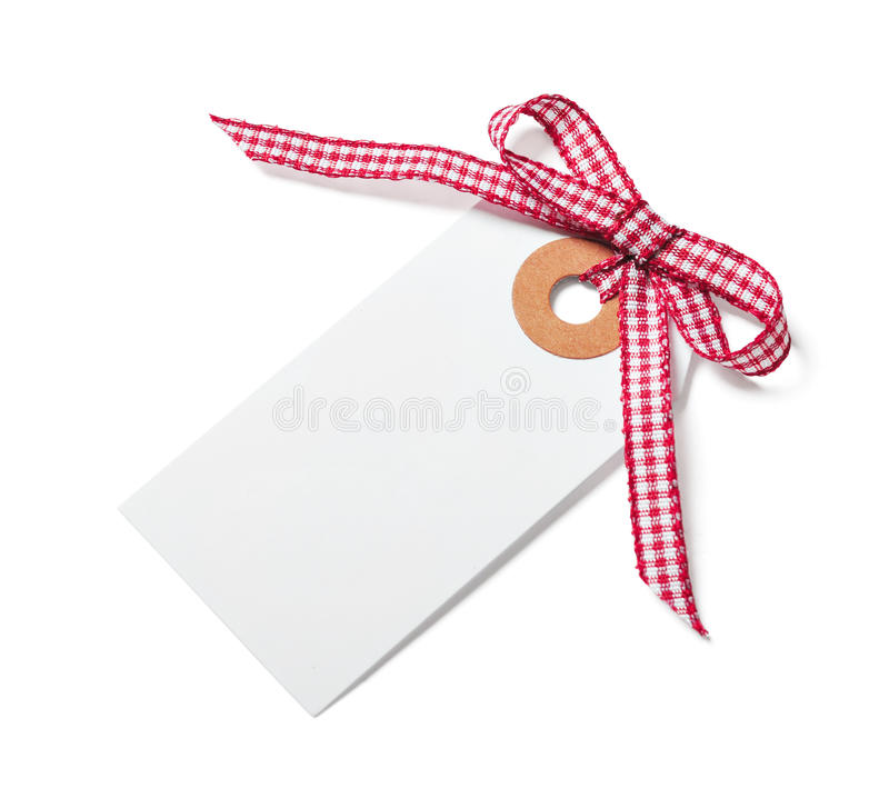 White tag with red ribbon. Bow isolated on white royalty free stock image