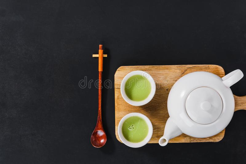 White tea set. On wooden cutting board, top view stock photos