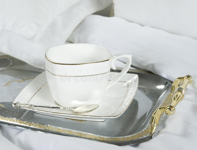 White teacup on the silver tray royalty free stock image