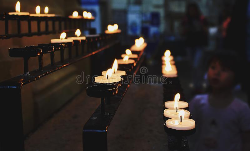 White Tealight Candles Lit during Nighttime royalty free stock images