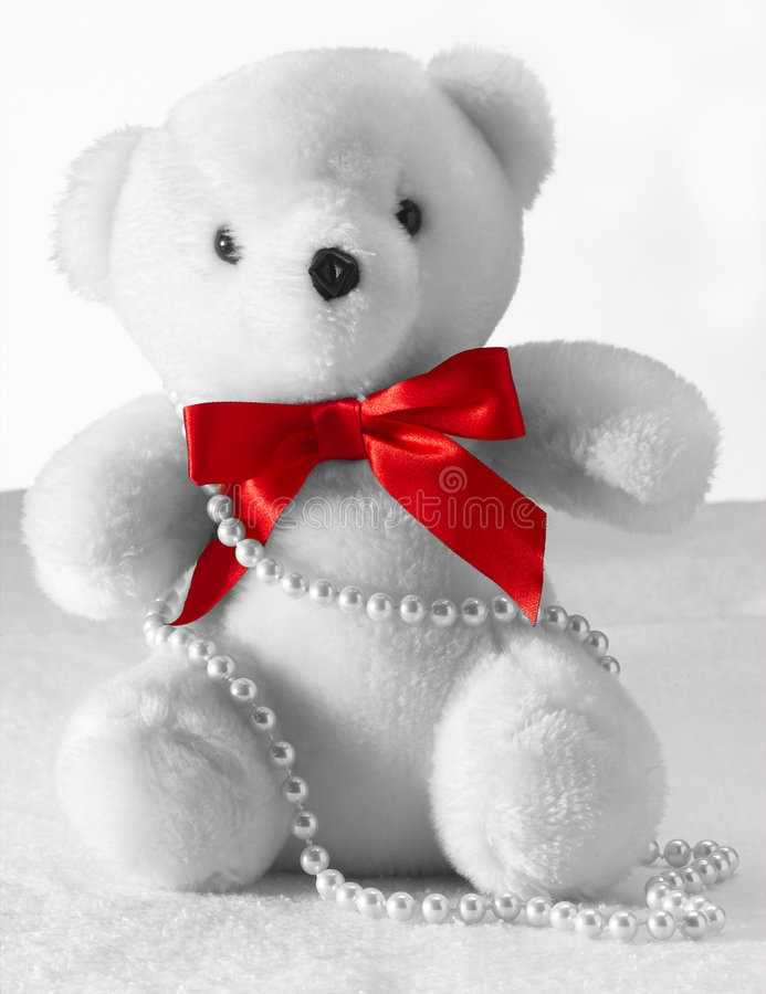 White Teddy Bear with Pearls stock images