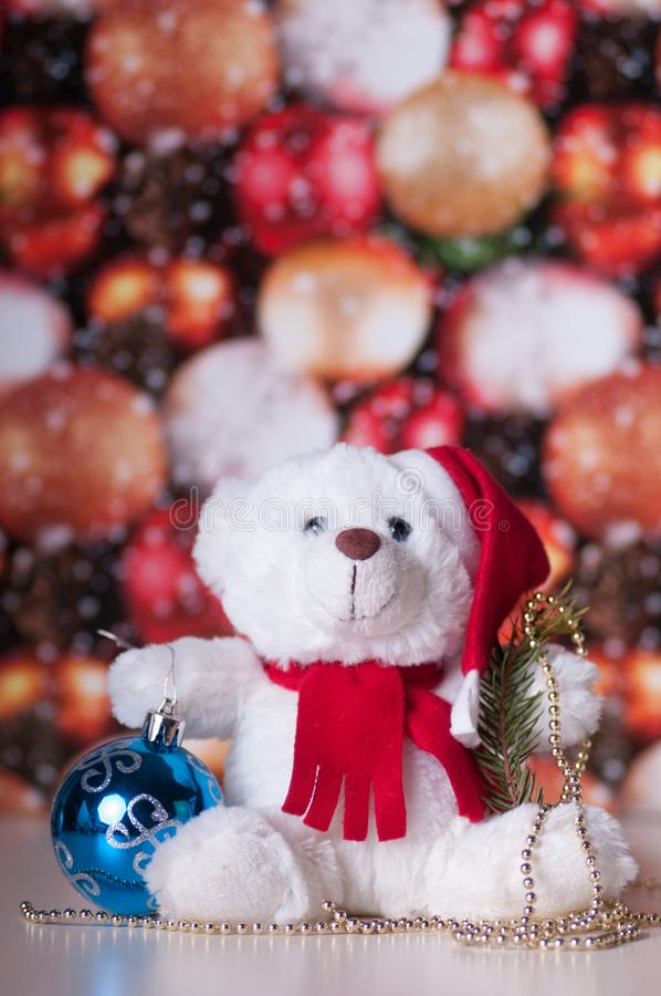 White teddy bear with presents stock photos