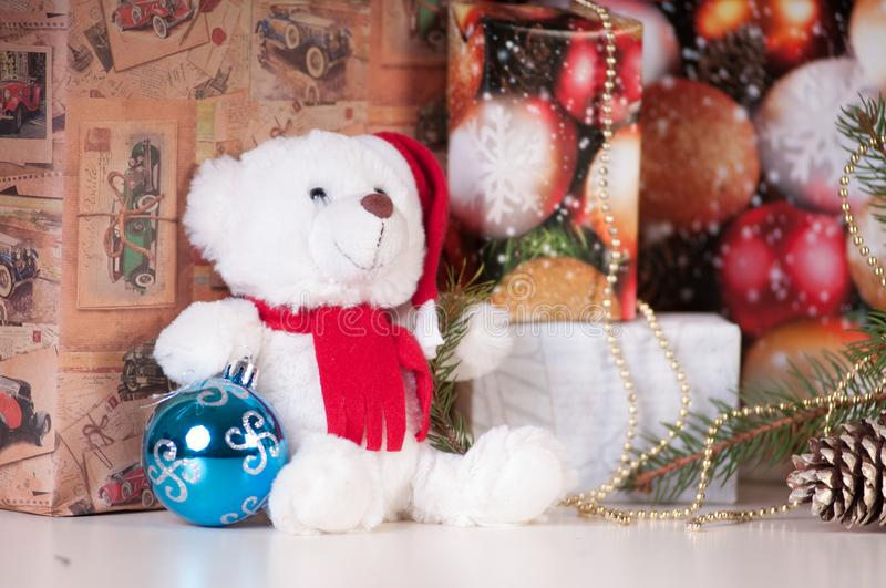 White teddy bear with presents royalty free stock photography