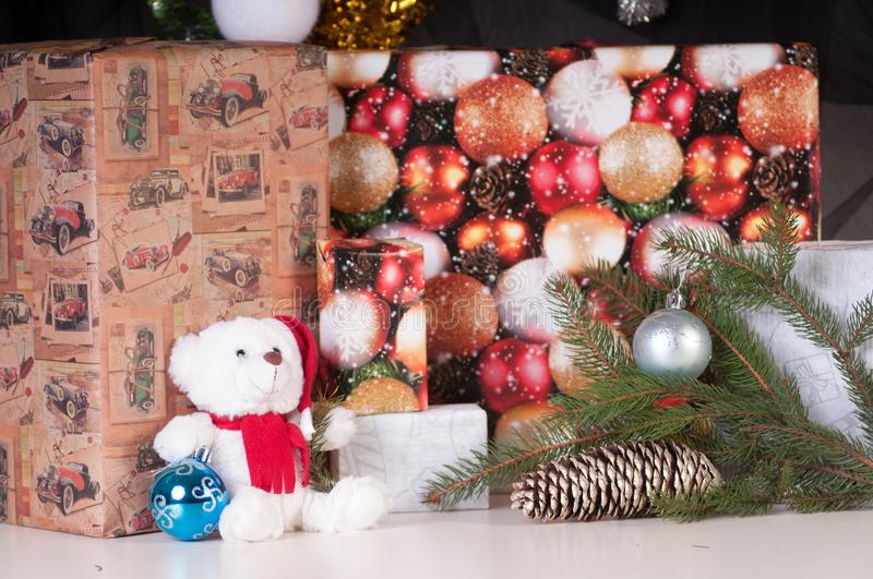 White teddy bear with presents stock photography