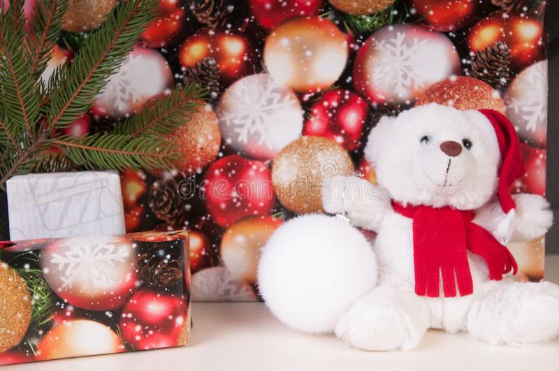 White teddy bear with presents royalty free stock photo