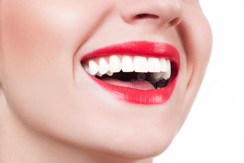 White teeth and red lips. Perfect female smile after whitening teeth. royalty free stock photos