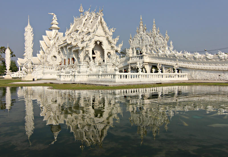 White Temple in Chiang Rai, Thailand. Sun reflects off of the White Temple in Chiang Rai, Thailand royalty free stock images
